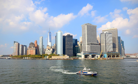 Lower Manhattan skyline on a Clear Blue day, Police Boat in foreground. New York City Stock Photo