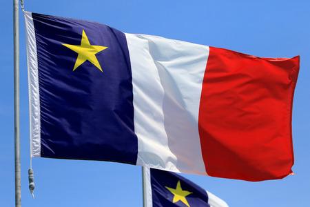 Acadian Flag with Blue Sky Background, Newfoundland, Canada