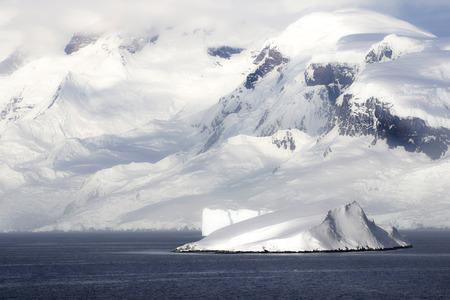 Antarctica on a Sunny day- Antarctic Peninsula - Huge Icebergs and blue sky. 写真素材