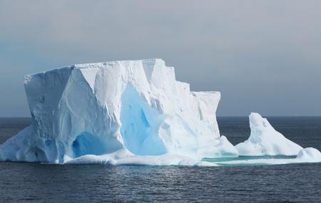 Antarctica on a Cloudy day- Antarctic Peninsula - Huge Icebergs and gray sky.
