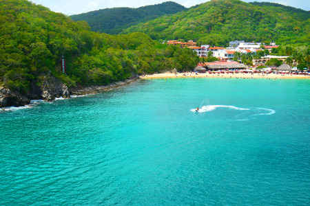 Jet Ski Tourist, Pristine Ocean and Forest. Santa Cruz Bay, Huatulco, Mexico Imagens