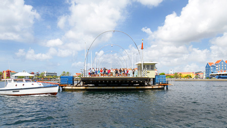 Willemstad, Curacao- Oct 16, 2018.  Tourists standing on Queen Emma Pontoon Bridge.  It is a swing bridge that opens to allow boats to enter St Anna Bay