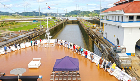 Cruise ship Approaching Locks at Panama Canal, Panama.  Unrecognizable People.
