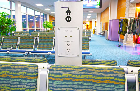 Public free charging station in international terminal airport for passenger or traveler. Фото со стока