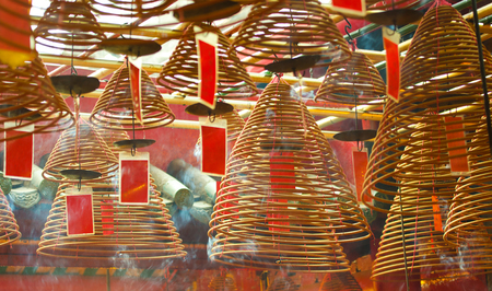 Burning incense coils with red Prayer Flags. Man Mo Temple, Hong Kong.  Landmark and a Popular tourist attractions 写真素材