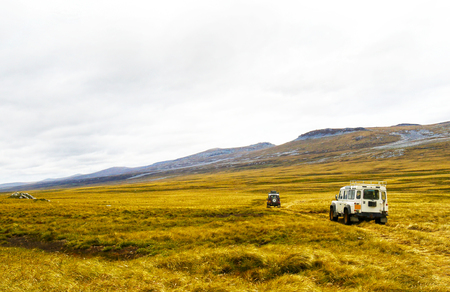 Off-road Vehicle Excursion over some Patagonian grasslands, in the Falkland Island. Popular Tourists Attraction. 写真素材