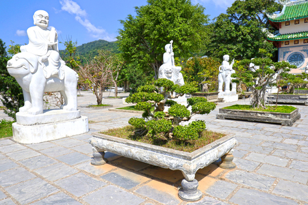 Buddha and Bonsai at Danang (Da Nang)  Linh Ung Temple, A Traditional Buddhist temple. Danang is a popular tourist destination of Asia