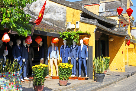 Sunny day at Hoian Ancient town, colourful houses and store fronts. Colourful buildings with festive silk lanterns. 写真素材