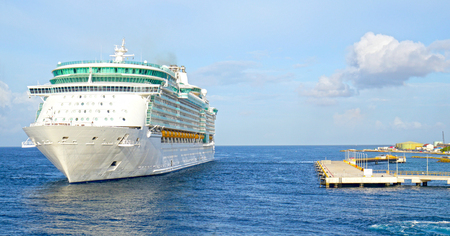 Unmarked Cruise Ship Maneuvering to Dock at Willemstad, Curacao.  The Dutch Antilles.   On a tropical sunny day. 写真素材