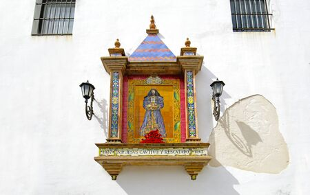 Santa Cruz Church façade featuring a typical Spanish Tile Mural of Jesus Christ Mosaic. Fray Felix Square, Cadiz, Andalusia, Spain 写真素材