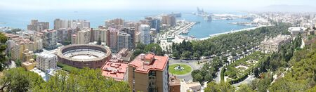 Malaga, Spain. Aerial panoramic view of the City and Harbor Front from Alcazaba Castle, Castillo de Gibralfaro,   on mountain top.