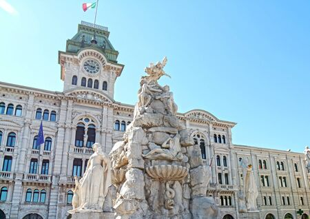 Trieste city hall on Piazza Unita d Italia square, Friuli Venezia Giulia region of Italy. Sharp Focus on Four Continent Fountain in Foreground