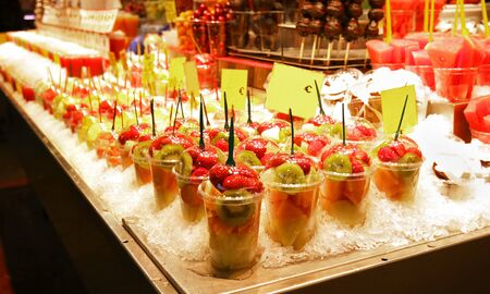 Barcelona Mercato. Colorful Fruit salads in plastic containers at the market