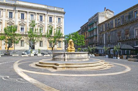 Water Fountain of Dolphins in Piazza Teatro Massimo, Catania, Sicily.  Italy