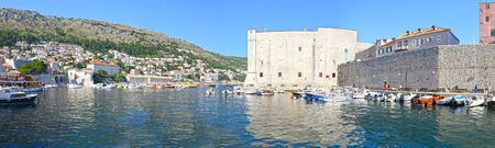 Panoramic view of  Dubrovnik, Croatia. Turquoise waters of Adriatic Sea.  Entrance to Dubrovnik inner harbour