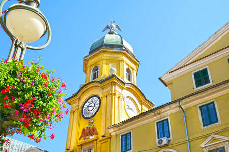 Rijeka Square clock with summer Flower Baskets on lamp post.  Kvarner, Croatia
