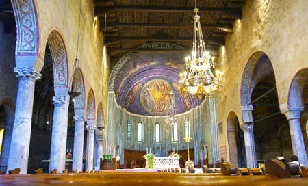 Trieste, Italy - June 30, 2019:  The Ornate Nave of the San Giusto Cathedral.