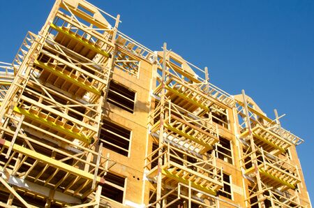 Apartment Condominium Complex, Wood Frame Construction, Victoria, Canada.  Blue Sky background