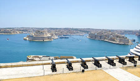 Saluting Battery of Cannons, Fort Lascaris St. Angelo of La Vittoriosa upper Barrakka gardens. Grand Harbor  in background