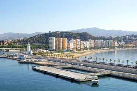 Cityscape of cruise ship terminal, waterfront and beach in Malaga, Andalusia, Spain