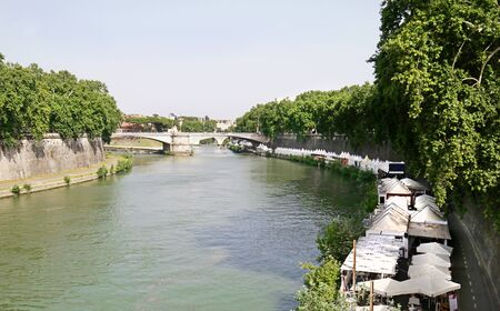 Rome, Italy.  Tiber river lined with many restaurants. Near Trastevere District