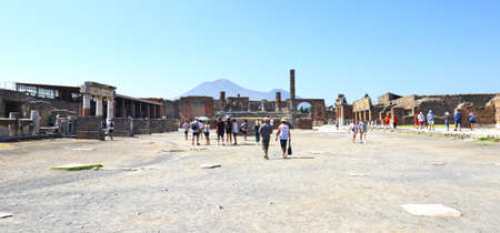 POMPEII, ITALY - July 6, 2019:  Pompeii was buried under ash in the eruption of Mount Vesuvius in 79. Its a UNESCO World Heritage Site.Its a UNESCO World Heritage Site. Vesuvius in Distant Backlground