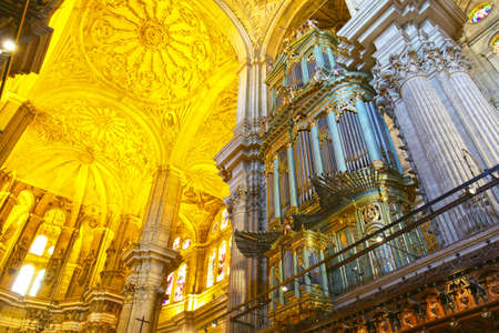 Malaga / Spain - Jun 17, 2019: Grand Organ of Cathedral of Incarnation, and Interior Architecture.  Malaga, Spain. Sajtókép