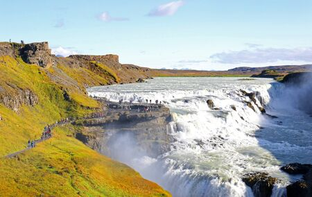 Gullfoss Waterfall is an impressive waterfall shrouded in clouds of mist.  Name meaning Golden Fall in Iceland