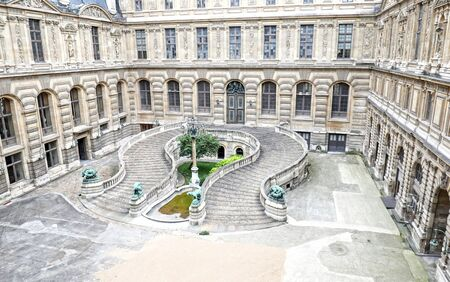Paris / France - Aug 30,2017:  Louvre Palace  Museum horseshoe shaped staircase in the outdoor courtyard. Empty with no tourists