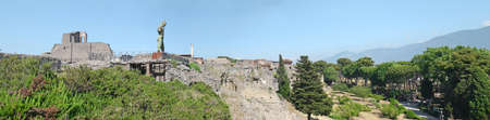 Pompeii / Italy - July 6, 2019:  Panoramic view of Ruins of Pompeii city destroyed in 79 B.C. by the eruption of Vesuvius Volcano , Italy.  Blue sky