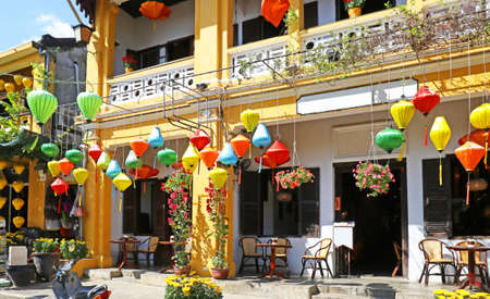 Sunny day at Hoian Ancient town, colourful houses. Colourful buildings with festive silk lanterns. UNESCO heritage site. Vietnam Sajtókép