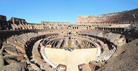 Panoramic View inside the Ruins of Colosseum,   Colosseo Roma. Unidentifiable Tourists and groups. Rome, Italy.