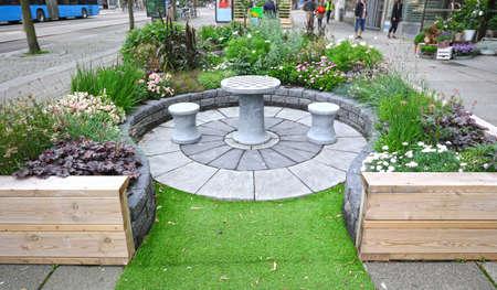 Temporary Sidewalk roadside outdoor garden and resting area. Gothenburg, Sweden.  Part of an experimental urban greening initiative.