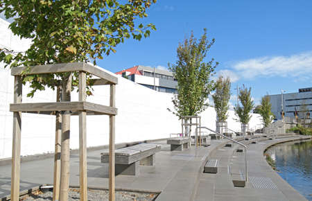 Christchurch,  New Zealand. Canterbury Earthquake Memorial Wall on side of Avon River with names of 185 lives lost engraved in white marble.