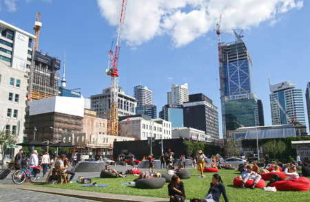 Auckland, New Zealand - April 15, 2019.  Young people resting and gathering at a city plaza with bean bag chairs. Urban Oasis green scape Publikacyjne