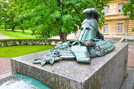 Helsinki, Finland - July 7, 2016 : Monument Ehrensvard in the form of knight's helmet sword and shield in the maritime fortress Suomenlinna Sveaborg