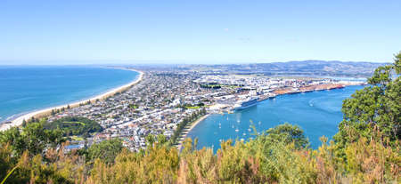 Tauranga, New Zealand. Panoramic view from Mount Maunganui of the white sand beach and City. Tauranga is a major cruise ship destination on northern island of New Zealand