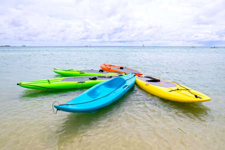 Rental Colorful Paddle Boards and Kayaks. on beach of Moorea, Tahiti.  French Polynesia. Tropical paradise.
