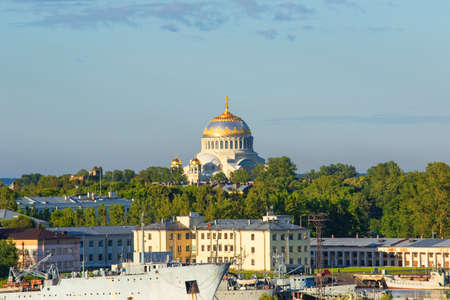 Landscape View of the Naval Cathedral of Saint Nicholas in Kronstadt near St. Petersburg, Russian Federation. Naval shipyard in the foreground. Early morning light. Zdjęcie Seryjne