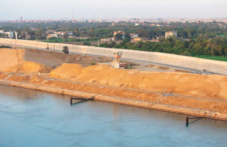 Suez Canal zone on the shore of Port of Suez, Egypt, Africa. Desert sand banks on the southern end of the Canal