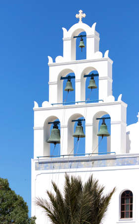 White Bell Tower of orthodox church of Panagia Platsani, in the village of Oia. Santorini. Greece