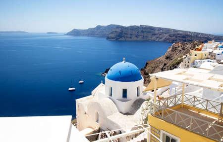 Oia village,Santorini. With blue Church domes and white washed houses on the Island of Santorini, Greece. Zdjęcie Seryjne