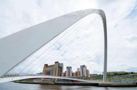 Arch of the Millennium Bridge. A Pedestrian Cyclist Tilting Bridge on The River Tyne.  Connecting Newcastle Upon Tyne and Gateshead, England, UK