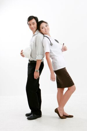 Portrait of young Physician lady and engineer standing together Stock Photo - 10409049