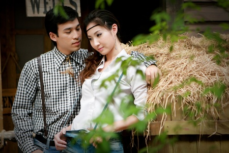 Portrait of young artistic couple in romantic emotion photo