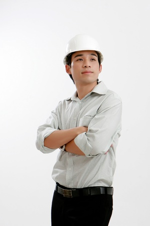Architect young engineer portrait hardhat isolated on white at studio  photo