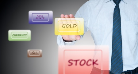 Businessman holding gold screen on transparent touchscreen photo
