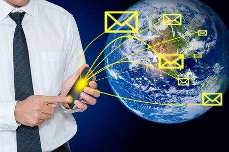 sent: Businessman sent email  via touchscreen  mobile phone  Stock Photo