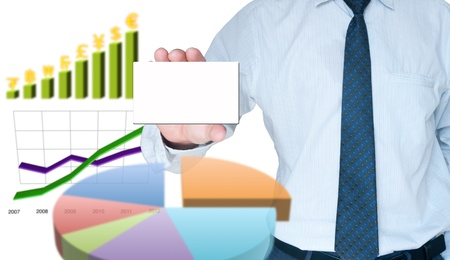 Businessman holding card surround with business graph Stock Photo - 10449244