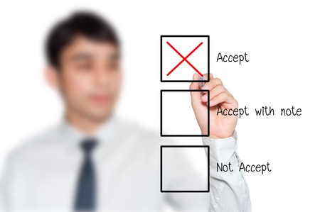 businessman making a positive decision by mark correct at Accept box photo